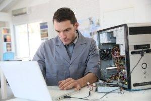 Computer Repair Technician Working on Computer