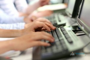View of Hands Typing on Keyboard