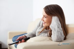 Happy Woman Watching TV