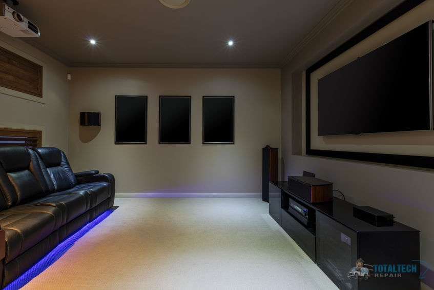 A Home Theater Room with a Projector and Leather Couch