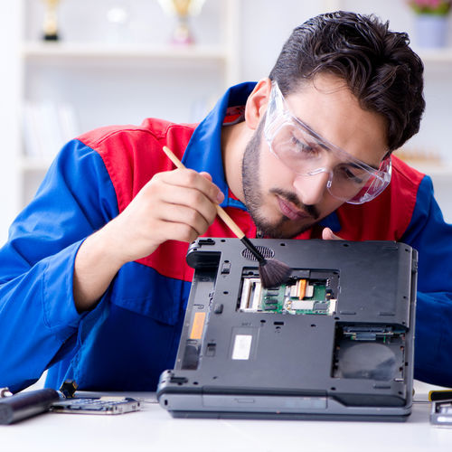 Technician Cleaning Hardware for Laptop Screen Repair