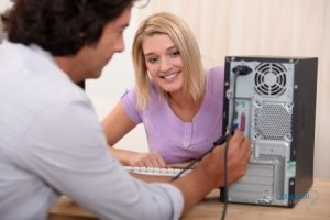Male Technician Repairing Computer