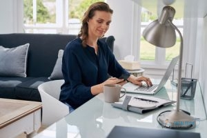 Middle-Aged Woman Using Computer at Home